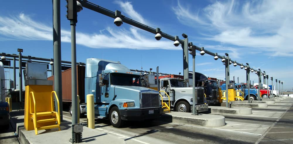About 100 truck drivers at the Ports of Los Angeles and Long Beach have gone on strike to protest their status as independent truck drivers as well as the costs to comply with clean air regulations.