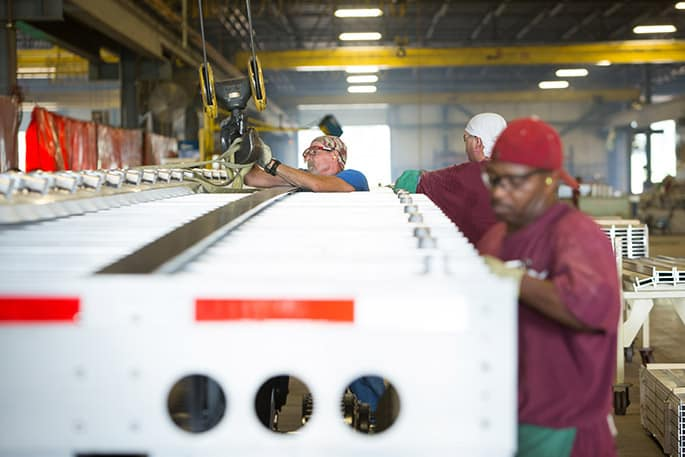 Workers build a trailer at Wabash National