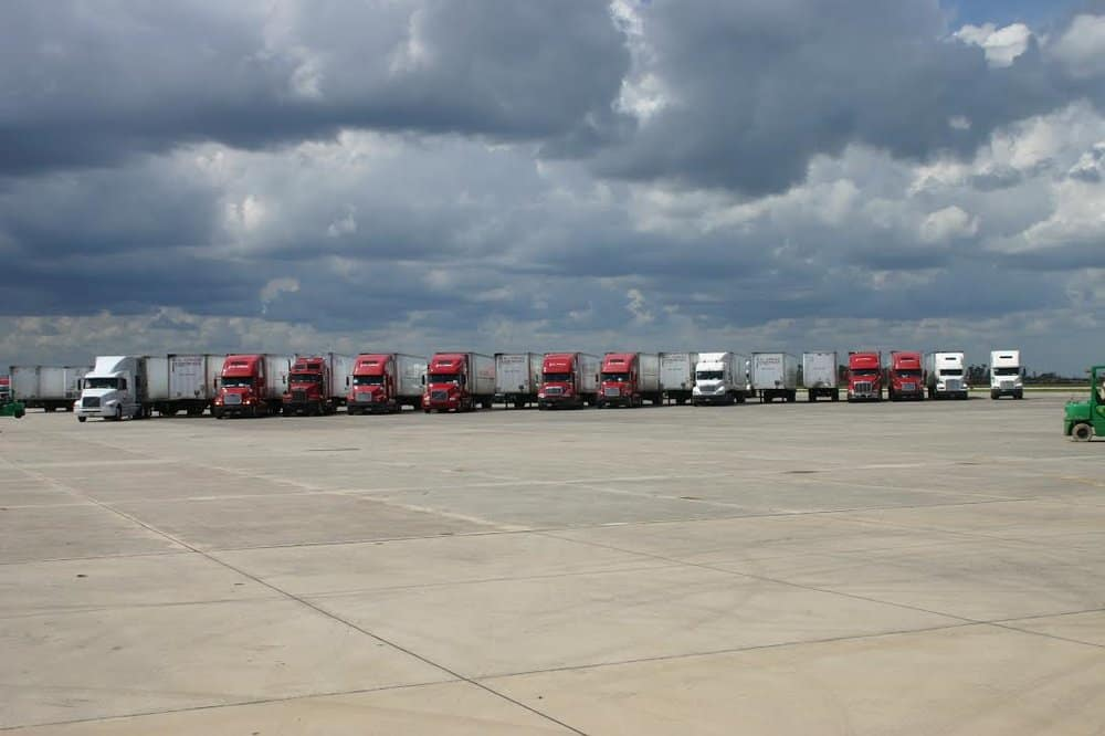 Trucks staged at a relief site waiting for dispatch to final point