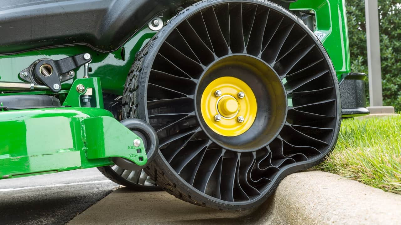 A Lawnmower S Airless Tire Deforms As It Rolls Over Curb