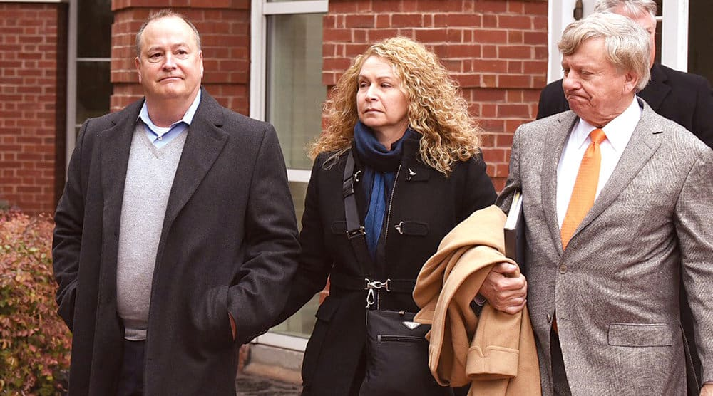 Former Pilot President Mark Hazelwood (left), accompanied by his wife and his lead attorney, Rusty Hardin.