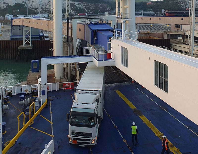 A truck drives onto a ferry at the Port of Dover in England. The port is fighting truck congestion and rents a lot not far away from the port to stage trucks if needed. ( Photo: Wikimedia Commons/ Ad Meskens )