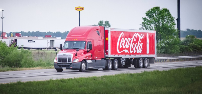 Branding your trucking company doesn't mean you must fully wrap trailers with your company name like Coca-Cola does, but it does require incorporating a branding campaign into your operation. ( Photo: Truckstockimages.com )