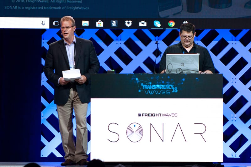 Ben Murphy drives the demo laptop during SONAR's public debut at Transparency18 last May. ( Photo: FreightWaves )