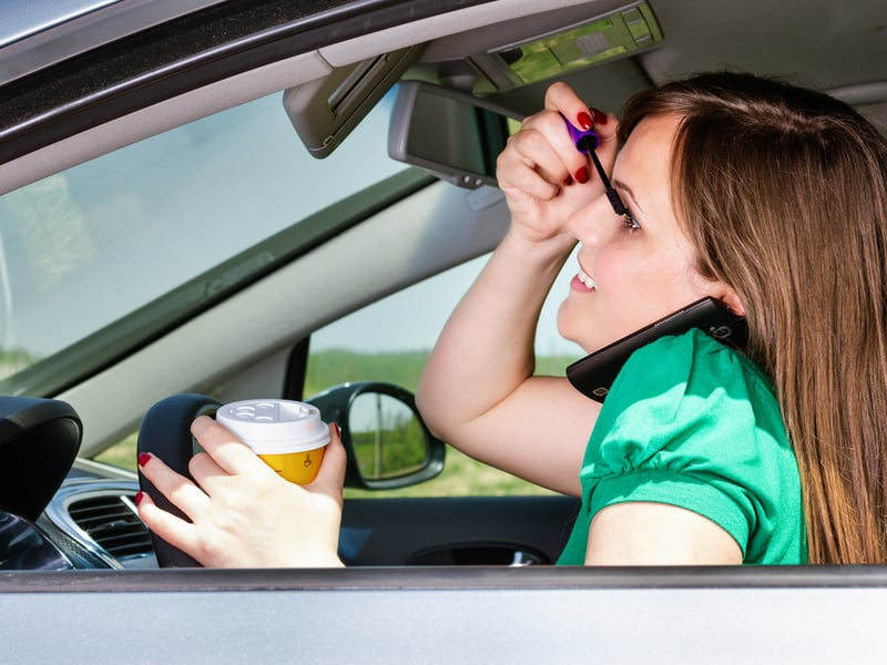 Australian drivers really do this while driving. Really.   (Photo: Shutterstock).