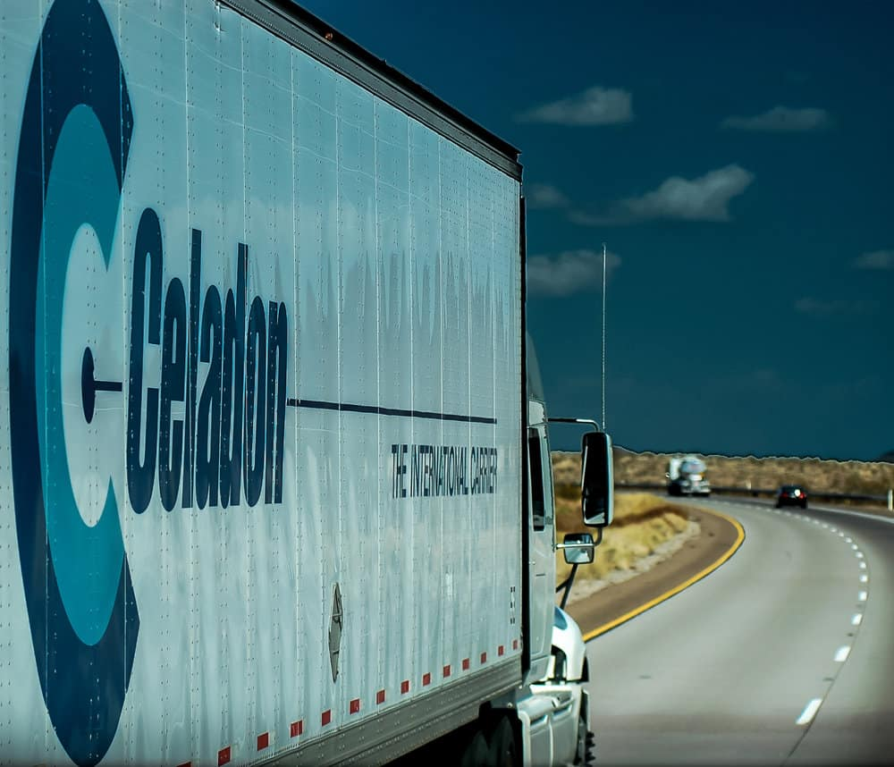 Celadon truck on the road