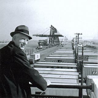 MALCOLM MCLEAN LOOKING AT INTERMODAL CONTAINERS. PHOTO COURTESY OF WIKIVIVIDLY.COM