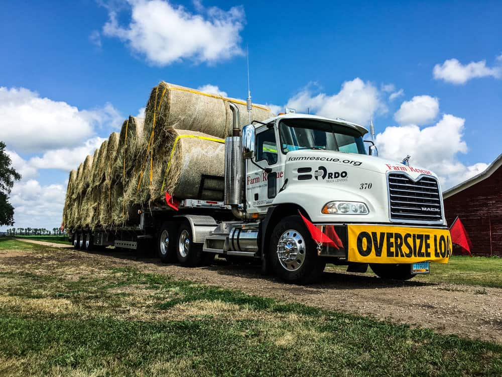 Hundreds of truck drivers across the Midwest volunteered their time to deliver hay bails to farmers affected by flooding in the MIdwest. ( Photo: Farm Rescue )