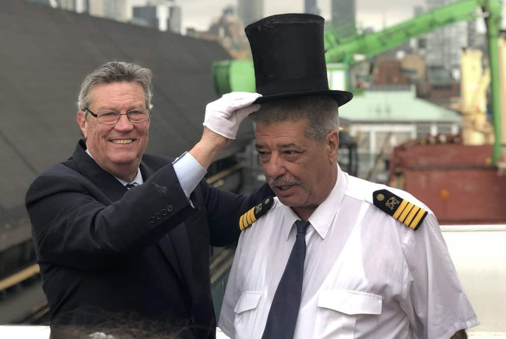 Toronto haror Master Emeritus Angus places a ceremonial top hat on Captain Pero Mikelic of the M/V Cape. Photo: Nate tabak