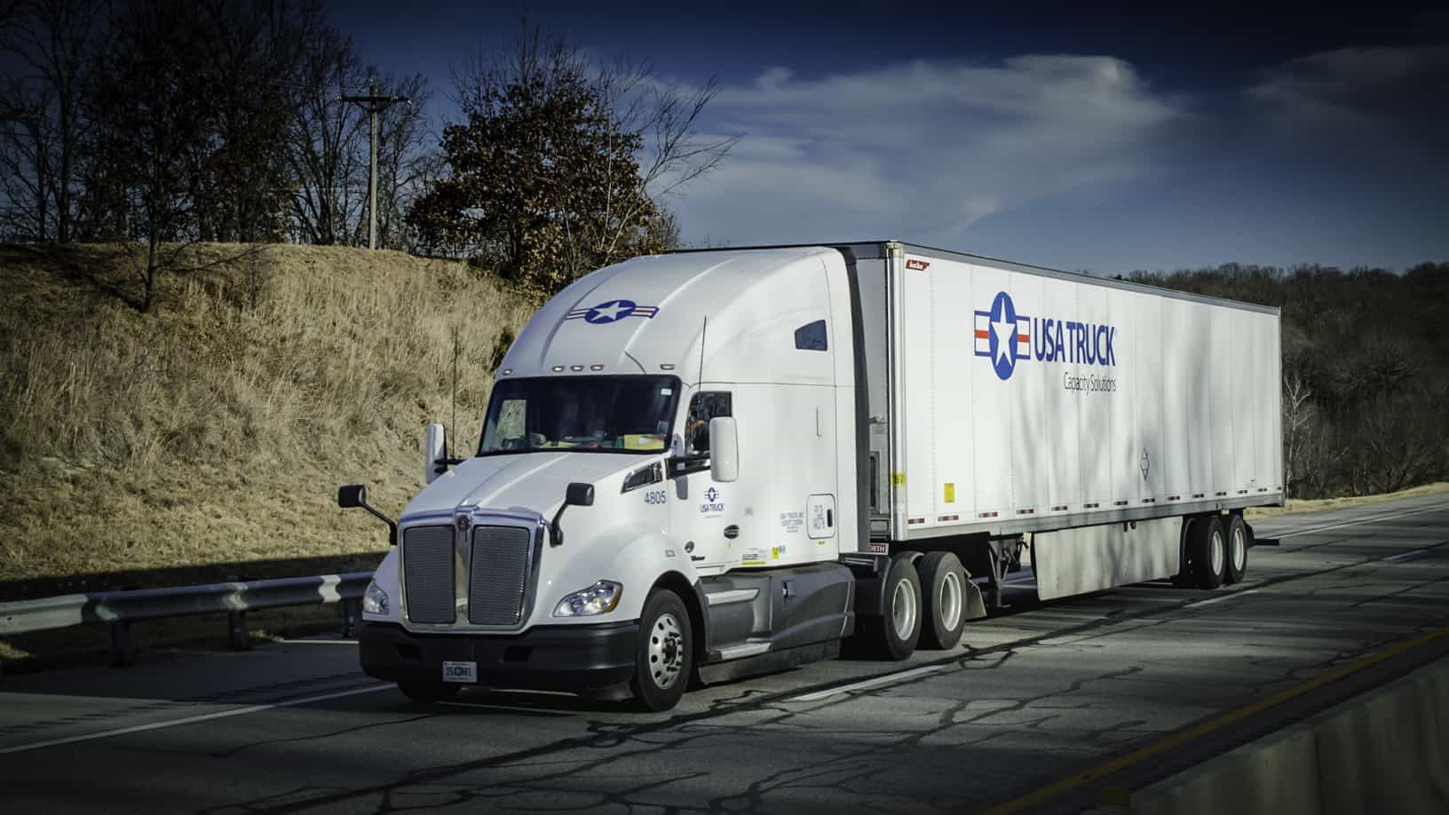 USA Truck blames soft freight environment, declining spot rates for