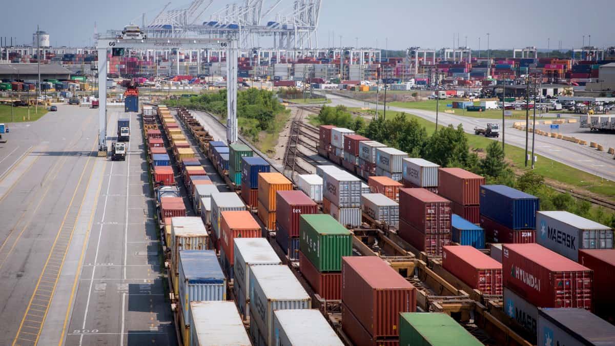 A photograph of five long lines of containers lined up next to each other.
