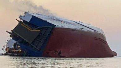 Photo of Coast Guard contacts four crew members in capsized car carrier