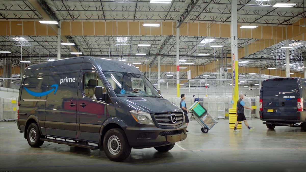 Amazon delivery van sits parked in a fulfillment center.