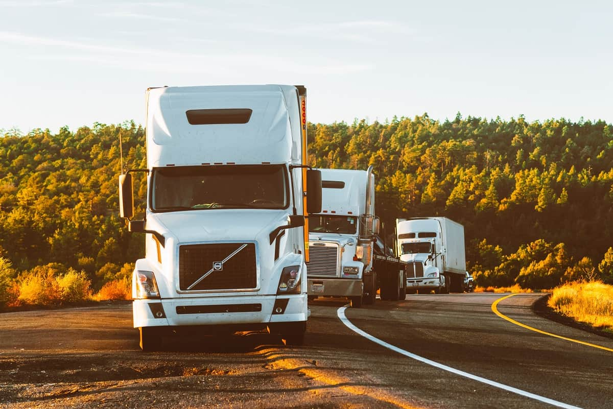 White truck convoy road forest roadside - stock - credit Quintin Gellar and Pexels
