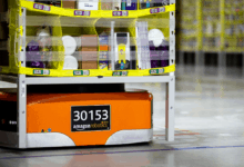 An Amazon Robotics Drive unit moves inventory in a warehouse.