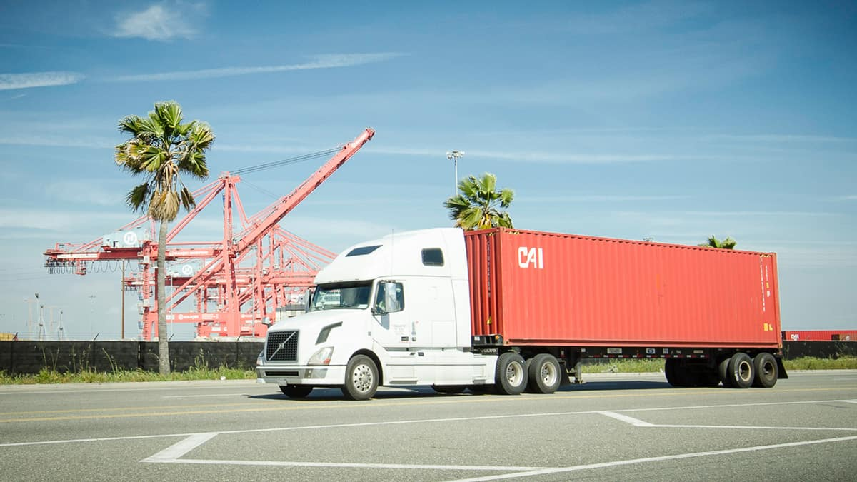 Truck moving a CAI container