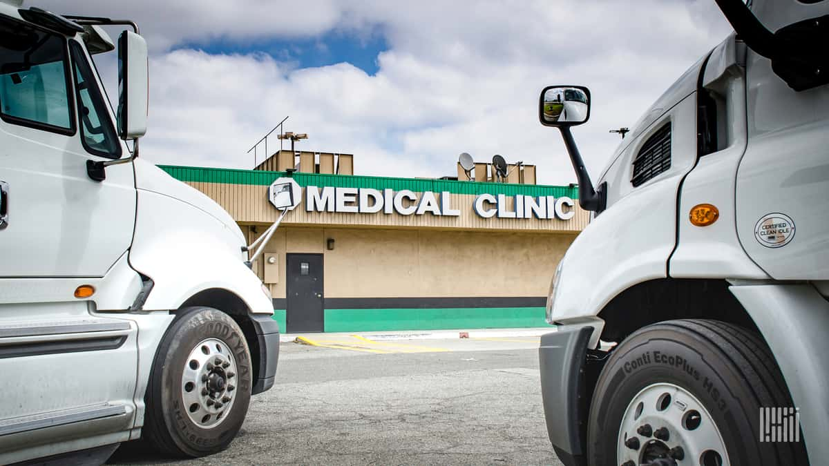 Trucks parked outside medical clinic.