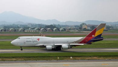 An Asiana jumbo jet on taxiway at Hanoi Airport