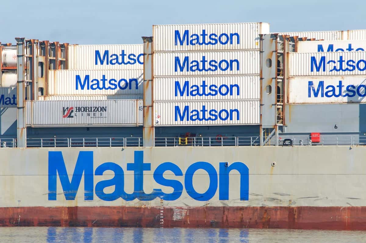 Pictures: ocean shipping containers stacked on a ship and all are bearing the Matson logo
