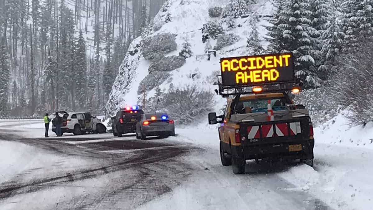 Accident on snowy Oregon highway.