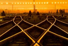 two railroad tracks at sunset