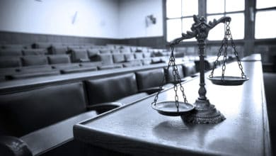 Pictured: scales, a symbol of law and justice. Photo: Shutterstock.