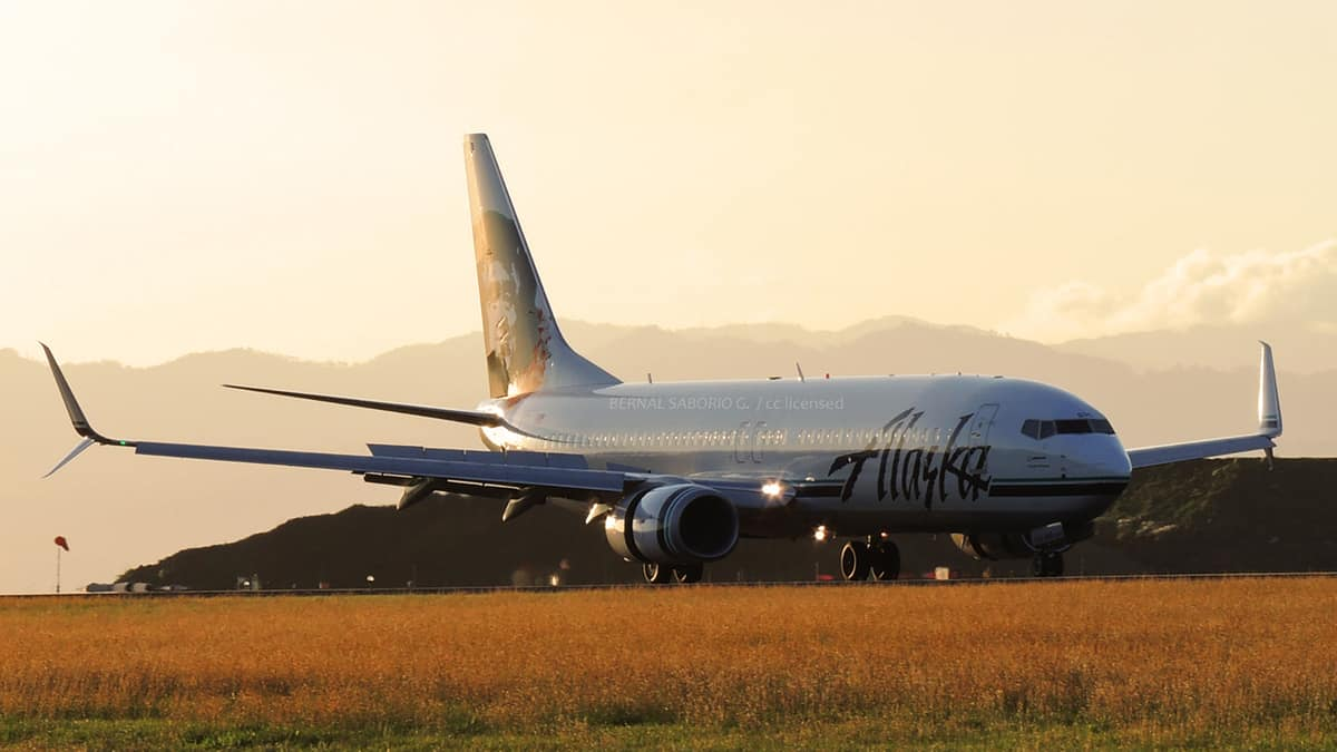 Alaska Airlines jet on the tarmac at sunset