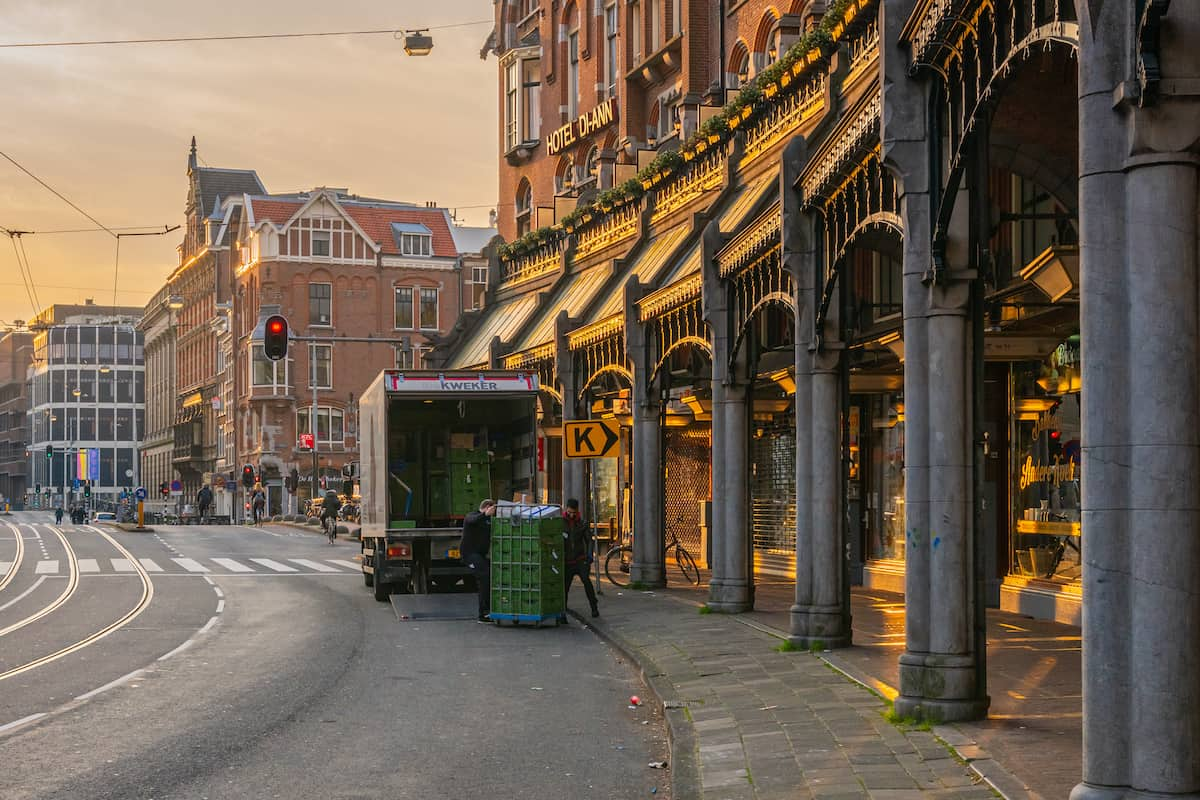 A truck makes a delivery in Amsterdam.