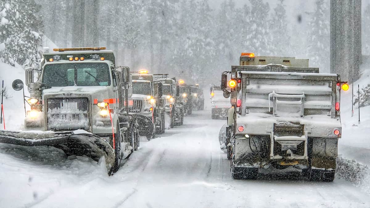 Snowplows clearing a road in California.