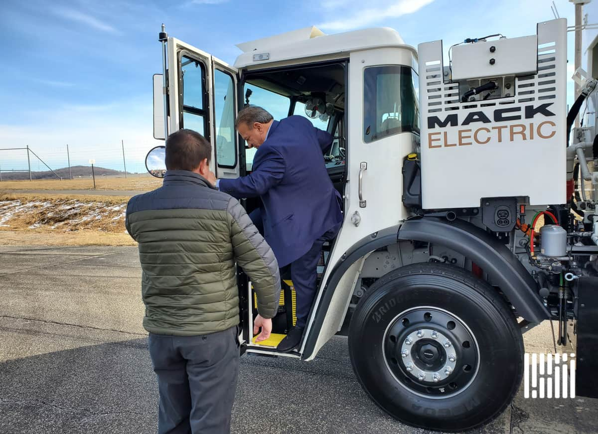NYC Sanitation Deputy Commissioner Rocky DiRico steps out of Mack LR Electric refuse truck