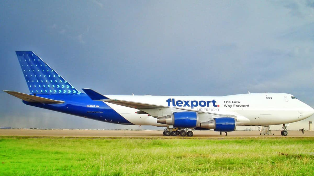 Blue jumbo jet on taxiway