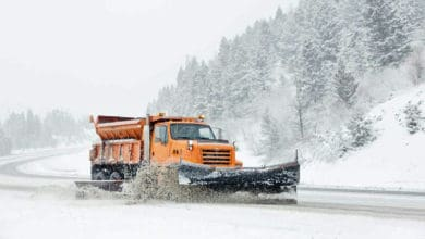 Snow plow on snowy mountain road in Montana.