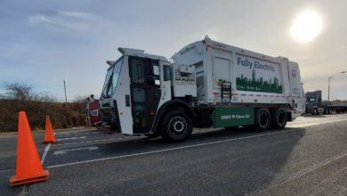 Photo of NYC Sanitation Department ready for Mack's first electric refuse truck