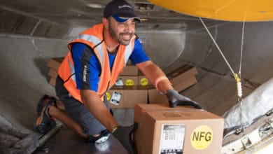 Guy working in cargo bay of plane