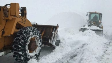 Plow on snowy road in Washington State.