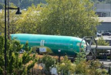 A 737 MAX fuselage waiting outside to enter factory.