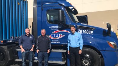NFI executives with Freightliner eCascadia