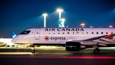 White Air Canada plane taxiing at night