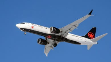 An Air Canada jet flying overhead