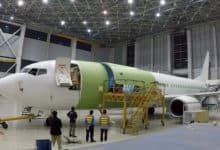 An older Boeing 737 gets ripped up in the shop and modified to carry cargo.