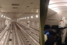 Disinfectant teams spray plane's cargo hold