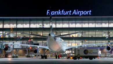 Rear view of plane parked at gate at Frankfurt Airport, nighttime