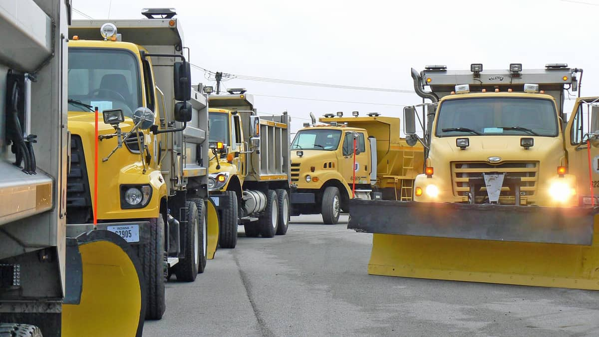 Plow trucks getting ready before an Indiana snowstorm.