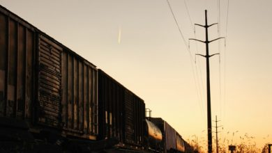A photograph of railcars taken at dusk.