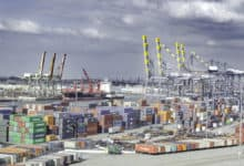 Stacks of shipping containers at a major port