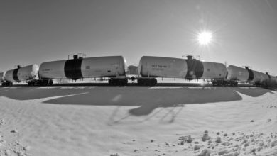 A photograph of four tank cars.