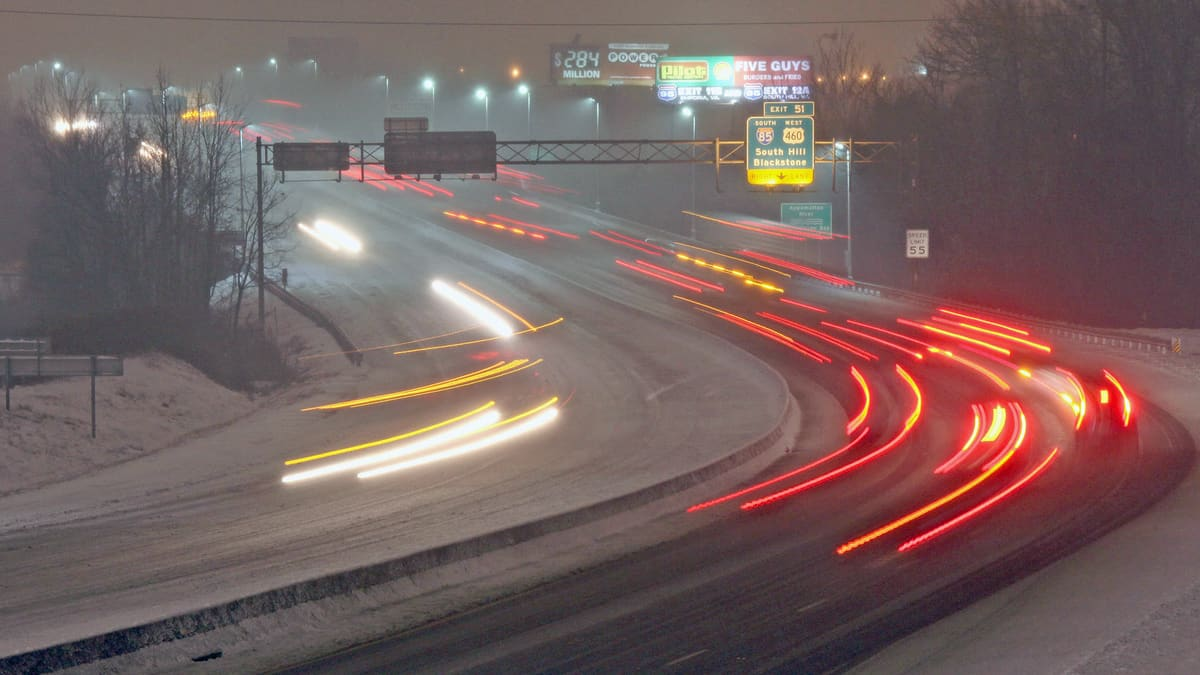 Vehicles on a snowy Virginia highway.