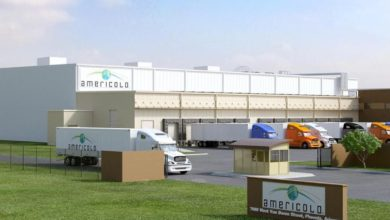 trucks loading/unloading at Americold facility