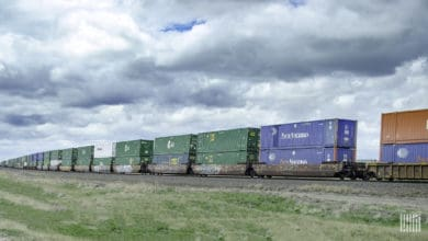 A photograph of a train carrying intermodal containers.