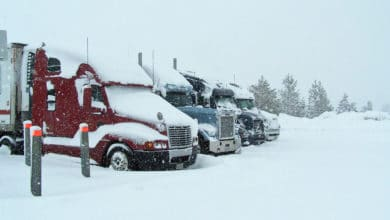 Tractor-trailers stopped at snowy Donner Pass, California.